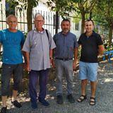Josef Lutter (li) und Fatjon (re) mit kirchlichen Partnern